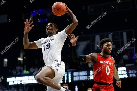 Naji Marshall, Chris McNeal. Xavier's Naji Marshall (13) goes up to dunk past Cincinnati's Chris McNeal (0) during the second half of an NCAA college basketball game, in Cincinnati