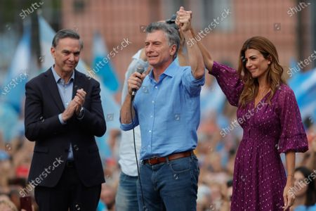 President of Argentina Mauricio Macri (C), politician Miguel Angel Pichetto (L) and the first lady Juliana Awada (R) cheer to supporters gathering in the Plaza de Mayo with the slogan 'More closer than ever', to say goodbye to Macri, the outgoing president, in Buenos Aires, Argentina, 07 December 2019. Macri, who called his followers to the Plaza de Mayo in front of the presidential house of Argentina, says goodbye three days ahead of his succesor Alberto Fernandez's resumption of office.