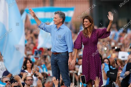 Stock Image of President of Argentina Mauricio Macri (L) and the first lady Juliana Awada (R) wave supporters gathering in the Plaza de Mayo with the slogan 'More closer than ever', to say goodbye to Macri, the outgoing president, in Buenos Aires, Argentina, 07 December 2019. Macri, who called his followers to the Plaza de Mayo in front of the presidential house of Argentina, says goodbye three days ahead of his succesor Alberto Fernandez's resumption of office.