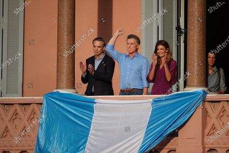 President of Argentina Mauricio Macri (C), politician Miguel Angel Pichetto (L) and the first lady Juliana Awada (R) greet supporters gathering in the Plaza de Mayo with the slogan 'More closer than ever', to say goodbye to Macri, the outgoing president, in Buenos Aires, Argentina, 07 December 2019. Macri, who called his followers to the Plaza de Mayo in front of the presidential house of Argentina, says goodbye three days ahead of his succesor Alberto Fernandez's resumption of office.