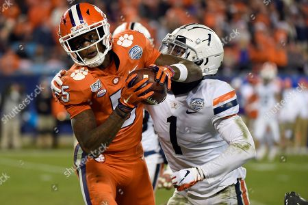 Clemson wide receiver Tee Higgins (5) catches a pass while Virginia cornerback Nick Grant (1) defends during the second half of the Atlantic Coast Conference championship NCAA college football game in Charlotte, N.C., . Clemson won 62-17