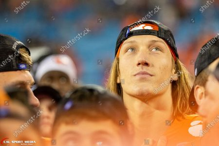 Clemson Tigers quarterback Trevor Lawrence (16) watches the game recap after winning the ACC Championship at Bank of America Stadium in Charlotte, NC