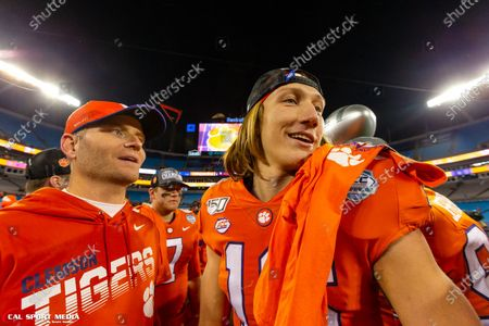 Clemson Tigers quarterback Trevor Lawrence (16) makes his way off the field after the ACC Championship at Bank of America Stadium in Charlotte, NC