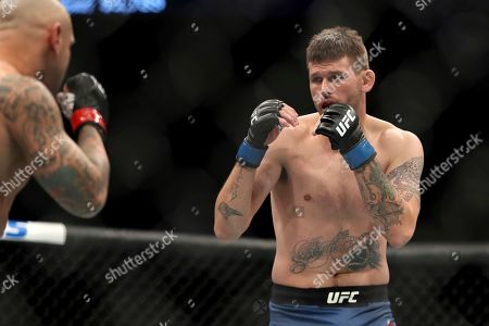 Tim Means, right, in action against Thiago Alves during their mixed martial arts bout at UFC Fight Night, in Washington, D.C. Means won via 1st round submission