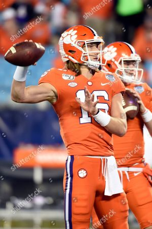 Clemson quarterback Trevor Lawrence (16) warms up prior to the Atlantic Coast Conference championship NCAA college football game against Clemson in Charlotte, N.C