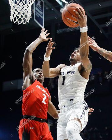 Paul Scruggs, Keith Williams. Xavier's Paul Scruggs (1) shoots against Cincinnati's Keith Williams (2) during the second half of an NCAA college basketball game, in Cincinnati