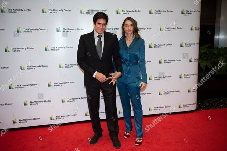Stock Picture of David Copperfield, Chloe Gosselin. David Copperfield, left, and Chloe Gosselin arrive at the State Department for the Kennedy Center Honors State Department Dinner, in Washington