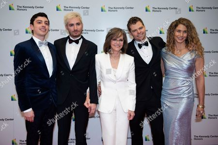 2019 Kennedy Center Honoree Sally Field, center, is joined by, from left, Armand De La Torre, Samuel Greisman, Eli Craig and Sasha Craig, as they arrive at the State Department for the Kennedy Center Honors State Department Dinner, in Washington