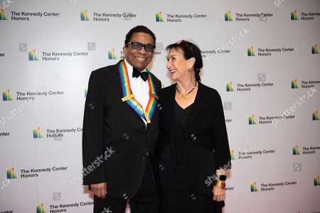 Herbie Hancock, Gigi Hancock. 2013 Kennedy Center Honoree Herbie Hancock, left, and his wife, Gigi Hancock, arrive at the State Department for the Kennedy Center Honors State Department Dinner, in Washington