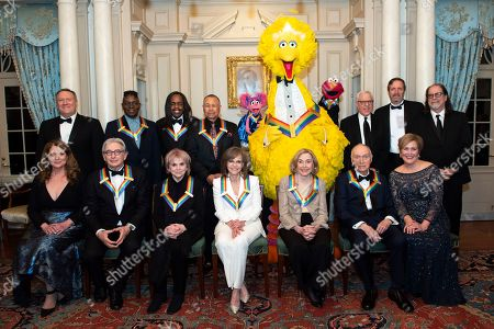 "Michael Tilson Thomas, Linda Ronstadt, Sally Field, Joan Ganz Cooney, Lloyd Morrisett, Deborah F. Rutter, Mike Pompeo, Susan Pompeo, Philip Bailey, Verdine White, Ralph Johnson, David M.Rubenstein, Ricky Kirshner, Glenn Weiss. Front row from left, Susan Pompeo, 2019 Kennedy Center Honorees Michael Tilson Thomas, Linda Ronstadt, Sally Field, Joan Ganz Cooney, Lloyd Morrisett and Kennedy Center President Deborah F. Rutter, back row from left, Secretary of State Mike Pompeo, 2019 Kennedy Center Honorees Philip Bailey, Verdine White, Ralph Johnson, characters from ""Sesame Street,"" Abby Cadabby, Big Bird, and Elmo, Kennedy Center Chairman David M. Rubenstein, Ricky Kirshner and Glenn Weiss pose for a group photo following the Kennedy Center Honors State Department Dinner at the State Department, in Washington"