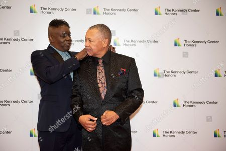 Philip Bailey, Ralph Johnson. 2019 Kennedy Center Honorees Earth, Wind & Fire Philip Bailey, left, fixes the collar of bandmate Ralph Johnson as they arrive at the State Department for the Kennedy Center Honors State Department Dinner, in Washington