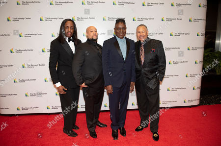 2019 Kennedy Center Honorees Earth, Wind & Fire members, from left, bassist Verdine White, the son of Maurice White, Kahbran White, singer Philip Bailey and percussionist Ralph Johnson arrive at the State Department for the Kennedy Center Honors State Department Dinner, in Washington. Earth, Wind & Fire founder Maurice White died in 2016