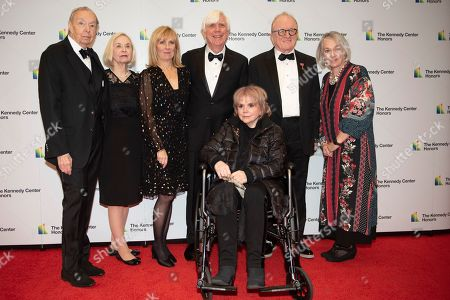 2019 Kennedy Center Honoree singer Linda Ronstadt, bottom center, is join by, from left, Shelly Schultz, Susan Schultz, Jill Boylan, John Boylan, Peter Asher, and Janet Stark at the State Department for the Kennedy Center Honors State Department Dinner, in Washington