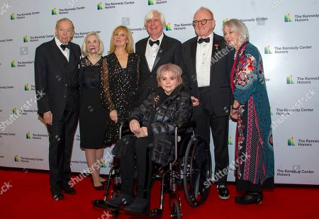 Stock Image of Linda Ronstadt arrives with, left to right, agent Shelly Schultz, and his wife, Susan, Jill Boylan and her husband, producer John Boylan, producer Peter Asher, and Assistant Janet Stark, arrive for the formal Artist's Dinner honoring the recipients of the 42nd Annual Kennedy Center Honors at the United States Department of State.