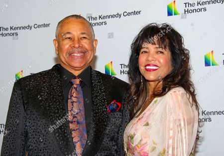 Percussionist Ralph Johnson of Earth, Wind and Fire and his wife, Susan Johnson, arrive for the formal Artist's Dinner honoring the recipients of the 42nd Annual Kennedy Center Honors at the United States Department of State.