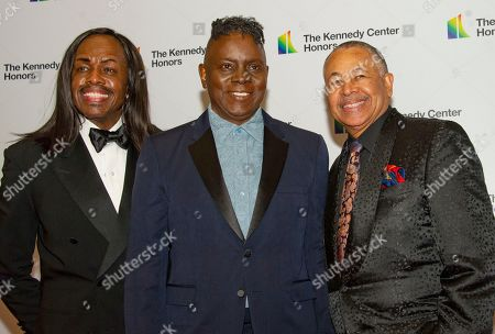 The band Earth, Wind & Fire, from left to right, bassist Verdine White, singer Philip Bailey, and percussionist Ralph Johnson arrive for the formal Artist's Dinner honoring the recipients of the 42nd Annual Kennedy Center Honors at the United States Department of State.