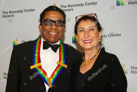 Herbie Hancock and his wife, Gigi, arrive for the formal Artist's Dinner honoring the recipients of the 42nd Annual Kennedy Center Honors at the United States Department of State.