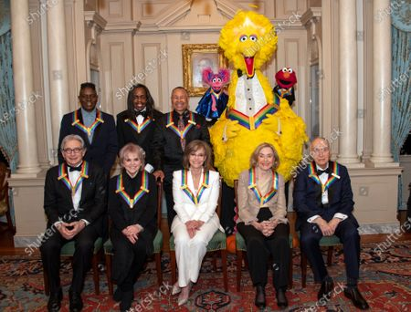 The recipients of the 42nd Annual Kennedy Center Honors pose for a group photo following a dinner at the United States Department of State in Washington, DC, USA, 07 December 2019. From left to right back row: from the band Earth, Wind & Fire, singer Philip Bailey, bassist Verdine White, and percussionist Ralph Johnson; from Sesame Street, Abby, Big Bird, and Elmo.  Front row, left to right: Michael Tilson Thomas; Linda Ronstadt; Sally Field; Sesame street founders Joan Ganz Cooney and Dr. Lloyd Morrisett.