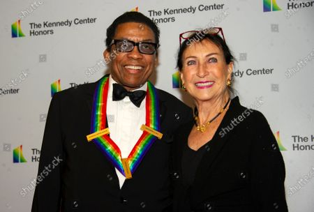 Stock Picture of Herbie Hancock and his wife, Gigi, arrive for the Artist's Dinner, honoring the recipients of the 42nd Annual Kennedy Center Honors, at the United States Department of State in Washington, DC, USA, 07 December 2019. The 2019 honorees were Earth, Wind & Fire, Sally Field, Linda Ronstadt, Sesame Street and Michael Tilson Thomas.