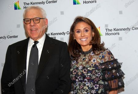 David M. Rubenstein, Chairman of the John F. Kennedy Center for the Performing Arts, and his daughter, Ellie, arrive for the Artist's Dinner, honoring the recipients of the 42nd Annual Kennedy Center Honors, at the United States Department of State in Washington, DC, USA, 07 December 2019. The 2019 honorees were Earth, Wind & Fire, Sally Field, Linda Ronstadt, Sesame Street and Michael Tilson Thomas.