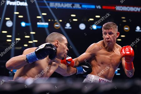 Britain's Chris Eubank Jr. punches Russia's Matt Korobov during the first round of a WBA interim middleweight boxing match, in New York