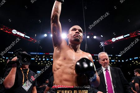Stock Picture of Britain's Chris Eubank Jr. celebrates after defeating Russia's Matt Korobov during the second round of a WBA interim middleweight boxing match, in New York