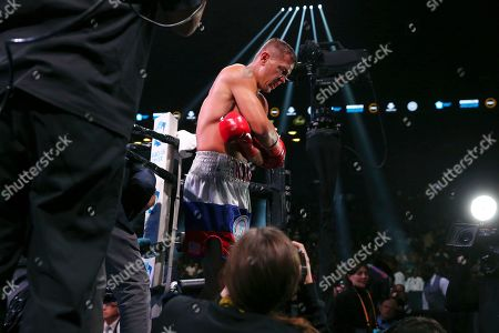 Russia's Matt Korobov leaves the ring after a loss to Britain's Chris Eubank Jr. during the second round of a WBA interim middleweight boxing match, in New York