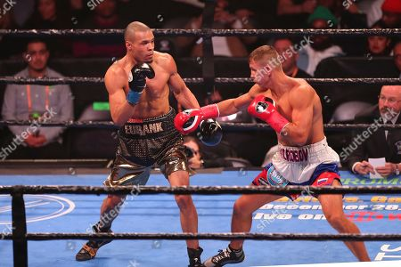 Chris Eubank Jr. (left) defends against opponent Matvey Korobov during a boxing match, in Brooklyn. Eubank won in second round by TKO