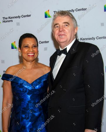Stock Picture of Harolyn Blackwell and Peter Greer arrive for the formal Artist's Dinner honoring the recipients of the 42nd Annual Kennedy Center Honors at the United States Department of State