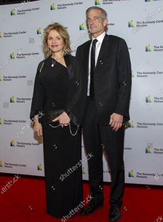 Stock Image of Renee Fleming and her husband, Tim Jessell arrive for the formal Artist's Dinner honoring the recipients of the 42nd Annual Kennedy Center Honors at the United States Department of State