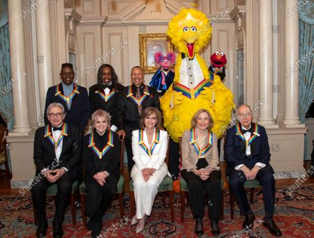 The recipients of the 42nd Annual Kennedy Center Honors pose for a group photo following a dinner at the United States Department of State in Washington, D.C.. From left to right back row: from the band Earth, Wind & Fire, singer Philip Bailey, bassist Verdine White, and percussionist Ralph Johnson ; from Sesame Street, Abby, Big Bird, and Elmo. Front row, left to right: Michael Tilson Thomas; Linda Ronstadt ; Sally Field ; Sesame street founders Joan Ganz Cooney and Dr. Lloyd Morrisett. The 2019 honorees are: Earth, Wind & Fire, Sally Field, Linda Ronstadt, Sesame Street, and Michael Tilson Thomas.