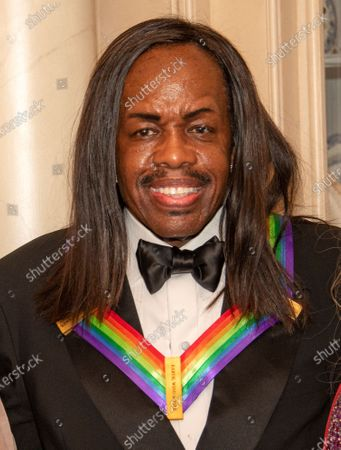 Bassist Verdine White of the band Earth, Wind and Fire, one of the recipients of the 42nd Annual Kennedy Center Honors, poses as part of a group photo following a dinner at the United States Department of State in Washington, D.C.