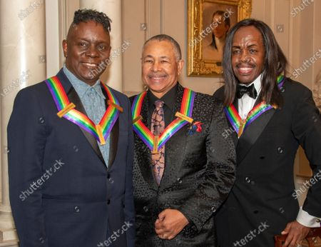 Members of the band Earth, Wind & Fire, from left to right, singer Philip Bailey, percussionist Ralph Johnson and bassist Verdine White, three of the recipients of the 42nd Annual Kennedy Center Honors pose for a group photo following a dinner at the United States Department of State in Washington, D.C.