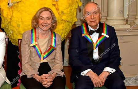 Sesame Street co-founders Joan Ganz Cooney, left, and Dr. Lloyd Morrisett, right, two of the recipients of the 42nd Annual Kennedy Center Honors, pose as part of a group photo following a dinner at the United States Department of State in Washington, D.C.