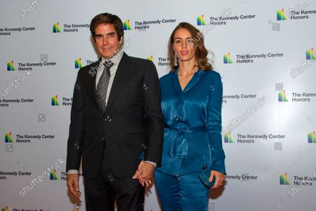 David Copperfield and Chloe Gosselin arrive for the formal Artist's Dinner honoring the recipients of the 42nd Annual Kennedy Center Honors at the United States Department of State