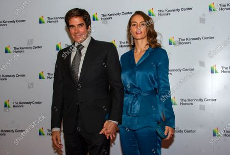 Stock Image of David Copperfield and Chloe Gosselin arrive for the formal Artist's Dinner honoring the recipients of the 42nd Annual Kennedy Center Honors at the United States Department of State