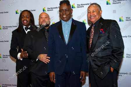 Earth, Wind & Fire members, from left, bassist Verdine White, Kahbran White, son of founder Maurice White who died in 2016, singer Philip Bailey and percussionist Ralph Johnson arrive for the formal Artist's Dinner honoring the recipients of the 42nd Annual Kennedy Center Honors at the United States Department of State