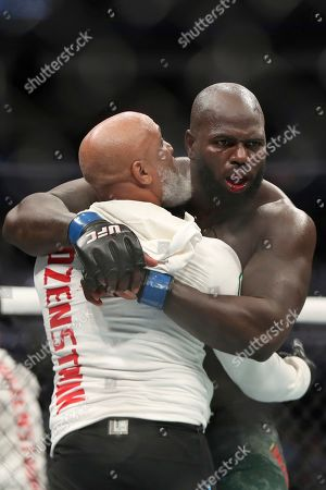 Jairzinho Rozenstruik celebrates with his cornerman after his win against Alistair Overeem in their heavyweight mixed martial arts bout at UFC Fight Night, in Washington, D.C. Rozenstruik won via 5th round TKO