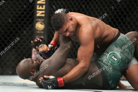 Alistair Overeem, top, in action against Jairzinho Rozenstruik during their heavyweight mixed martial arts bout at UFC Fight Night, in Washington, D.C. Rozenstruik won via 5th round TKO