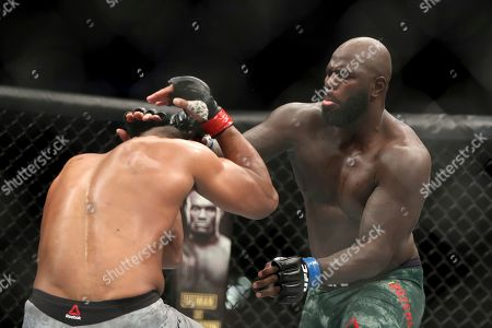 Jairzinho Rozenstruik, right, in action against Alistair Overeem during their heavyweight mixed martial arts bout at UFC Fight Night, in Washington, D.C. Rozenstruik won via 5th round TKO