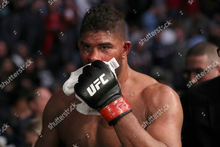 Alistair Overeem walks back to the locker room with a cut lip after being TKOd by Jairzinho Rozenstruik in their heavyweight mixed martial arts bout at UFC Fight Night, in Washington, D.C. Rozenstruik won via 5th round TKO
