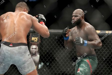 Stock Photo of Jairzinho Rozenstruik, right, pursues Alistair Overeem during their heavyweight mixed martial arts bout at UFC Fight Night, in Washington, D.C. Rozenstruik won via 5th round TKO