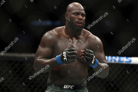 Stock Picture of Jairzinho Rozenstruik pursues Alistair Overeem during their heavyweight mixed martial arts bout at UFC Fight Night, in Washington, D.C. Rozenstruik won via 5th round TKO