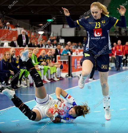 Stock Picture of Mireya Gonzalez (L) of Spain falls after colliding with Emma Lindqvist of Sweden during the IHF Women's World Championship main round match between Spain and Sweden in Kumamoto, Japan, 08 December 2019.