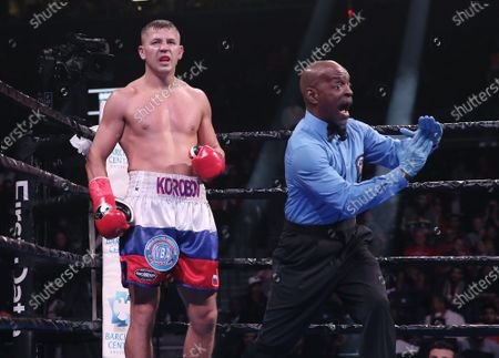 The referee (R) stops the World Boxing Association (WBA) interim middleweight world championship fight after Russia's Matt Korobov (L) could no longer fight due to a shoulder injury, against Britain's Chris Eubank Jr. at the Barclays Center in New York, USA, 07 December 2019.