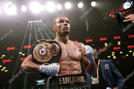 Stock Photo of Britain's Chris Eubank Jr. holds his championship belt after a technical knockout against Russia's Matt Korobov (not pictured)  during a World Boxing Association (WBA) interim middleweight world championship fight at the Barclays Center in New York, USA, 07 December 2019.