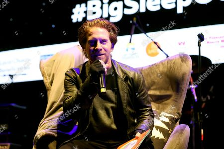 """Seth Green reads a bedtime story on stage at """"The World's Biggest Sleep Out"""" event at The Rose Bowl, in Pasadena, Calif"""