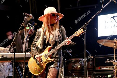 """Orianthi performs live on stage at """"The World's Biggest Sleep Out"""" event at The Rose Bowl, in Pasadena, Calif"""