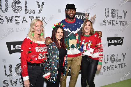 Stock Photo of LeBron James, Linda Rambis, Stacy Kennedy and Jeanie Buss