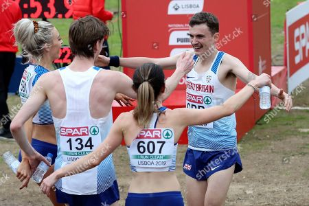 Stock Photo of Jonny Davies of Britain, right, joins his teammates after crossing the finish line to win the Mixed Relay 4 x 1500 meters race during the European Cross Country Championships at the Bela Vista park in Lisbon
